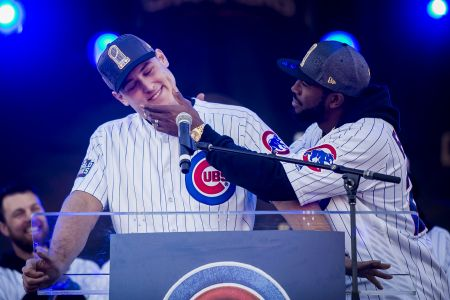 Dexter Fowler comforts Anthony Rizzo as he gets choked up honoring David Ross during the Chicago Cubs World Series rally in Grant Park. | Ashlee Rezin/Sun-Times