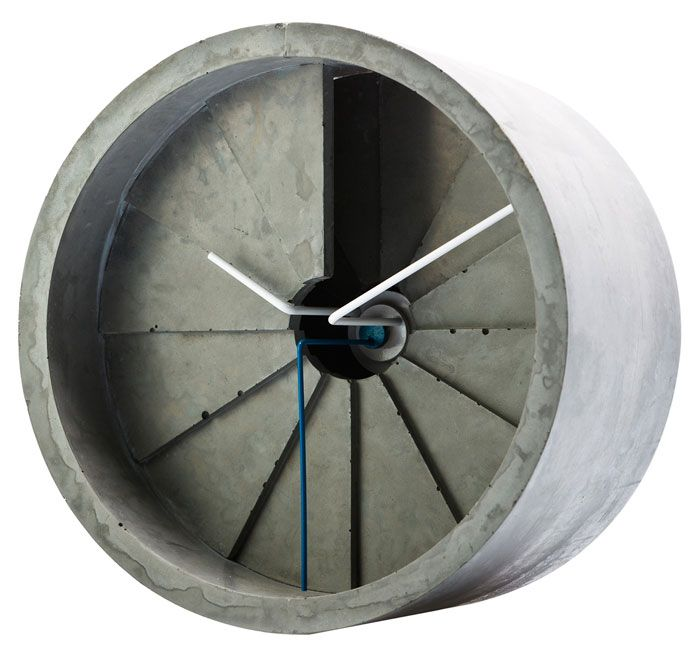 22designstudio 4th Dimension Concrete Clock - Blue    This 4th Dimension Clock design is intriguingly beautiful and considered. Each hour is represented by a triangular segment of concrete, tiered downwards to resemble a spiral staircase. The hands of the clock sit on the top tier and light and shadows change with time.    Created by Taiwan-based designers, 22designstudio - best known for their work with cement materials.    Presented in timber box.    Dimensions: 150 x 150 x 85mm