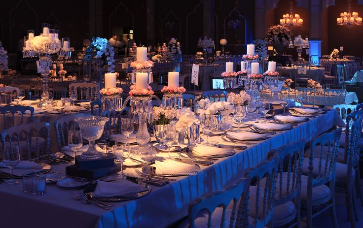 Candle centerpieces decorated with roses will help you to create the atmoshpere of romance.