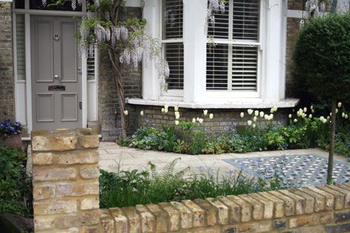London Front Garden by garden designer Joanna Archer. Repositioned entrance to avoid straight path
