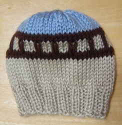 This adorable Train Tracks Baby Hat is a great gift for a baby boy. This #knit hat pattern has a design that look like little train tracks. You can use either use a size 8 circular needle (for magic loop) or a set of size 8 double pointed needles for this pattern.