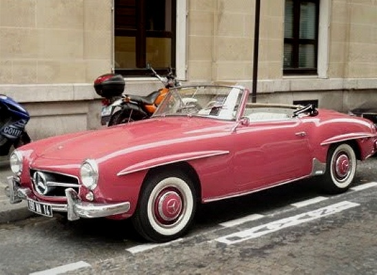 vintage pink Mercedes, parked on a Parisian street…