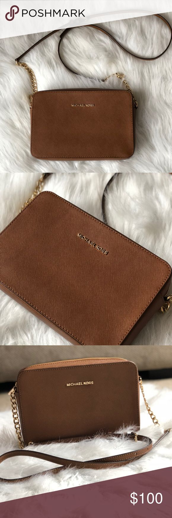 Micheal kors jet set travel large crossbody Micheal kors jet set travel large crossbody  •authentic Micheal kors crossbody •gently used in great condition  •no scratch or stain •brown •accepting reasonable offers Michael Kors Bags Crossbody Bags