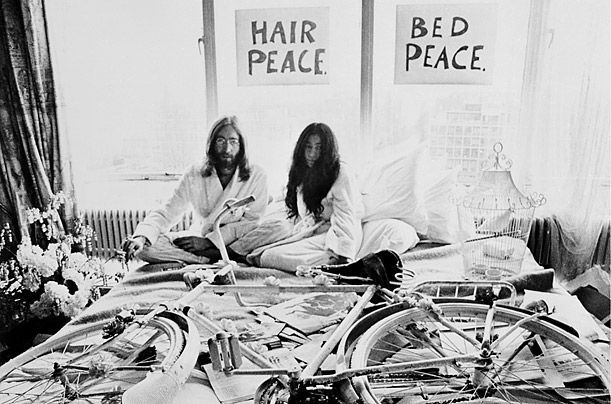 1969-Knowing that their wedding would cause a huge stir in the press, John Lennon and Yoko Ono decided to use their honeymoon to help champion world peace.