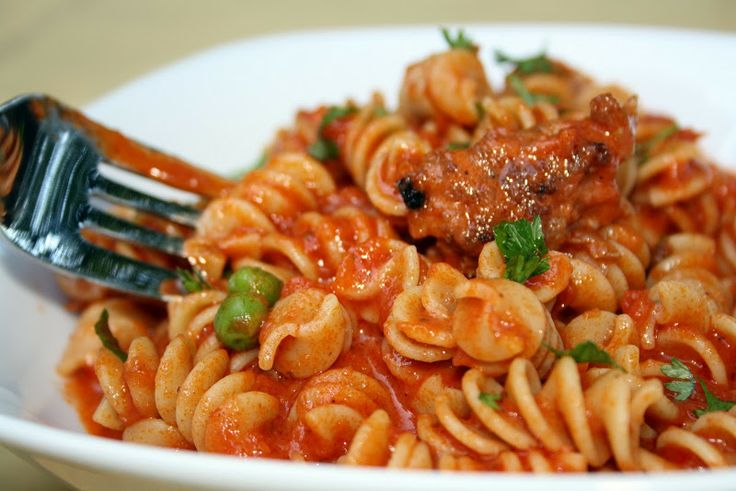 Speedy Weeknight Pasta with Sausage Tomatoes Peas and Herbs