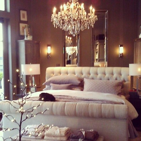 Tufted bed, beveled mirrors, crystal chandelier... So me!