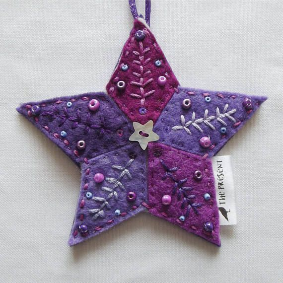 Felt Star Decoration, entirely hand cut and stitched. 5 diamond shapes in 5 shades of purple felt, stitched onto a purple felt backing, with an additional layer of thick felt inside to give it body. Embroidered in 5 different complementary shades of purple thread, embellished with a #feltornaments