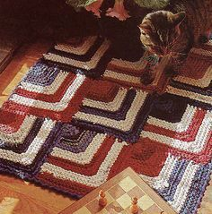 Free Knitting Pattern for Tee Shirt Rag Rug - Rug made of mitered squares knit with tee shirt fabric. Designed by Jana Trent