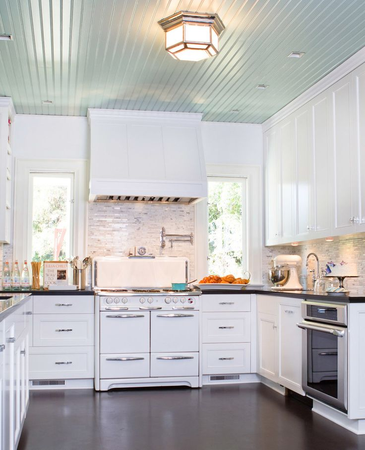 Remarkable beadboard ceiling with copper rangehood and white kitchen cabinet also pot filler faucet for modern kitchen design ideas