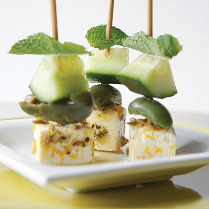Marinated Feta and Olive Skewers 2 teaspoons fennel seeds 2 teaspoons orange zest 3 tablespoons fresh orange juice 1 teaspoon freshly ground black pepper 4 ounces feta cheese, cut into 24 (1/2-inch) cubes 24 (6-inch) wooden skewers 24 fresh mint leaves 12 pitted green olives, halved 1/4 large English cucumber, seeded and cut into 1/2-inch chunks