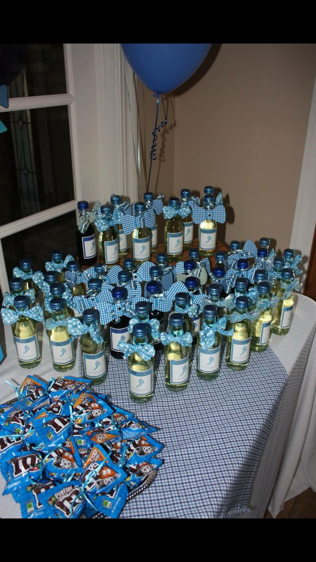 Bow tie decorated wine bottles.
