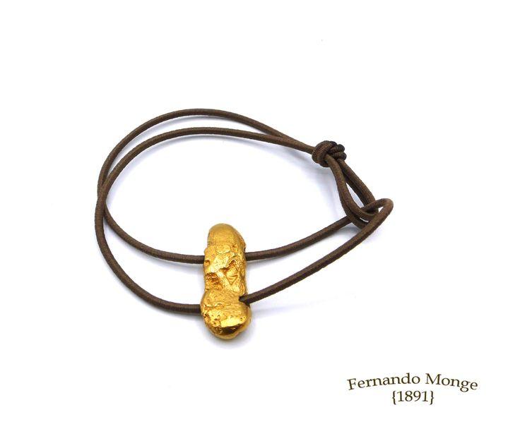Pulseras stones de plata con baño de oro amarillo  goma elástica. Fernando Monge 1891.