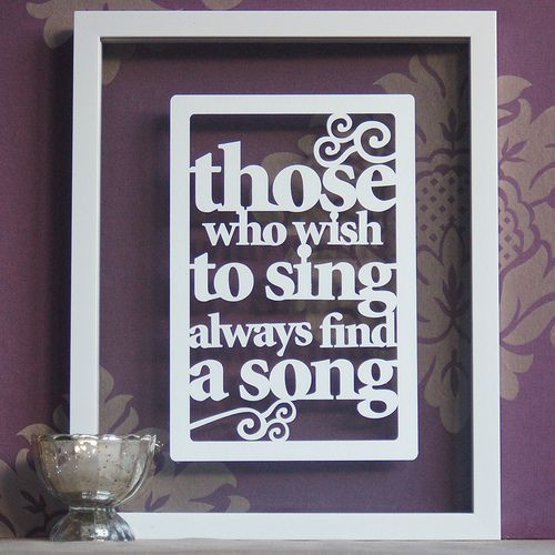 Love these. Paper cut quotes. Cut out the quote and/or design & put in a floating frame.