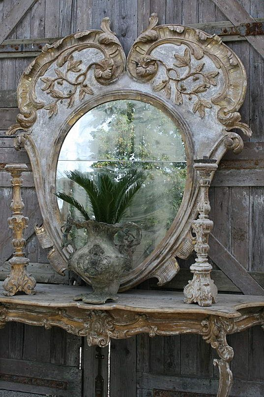 Shabby rusticness - oh so awesome.  Mirror, table & candlesticks
