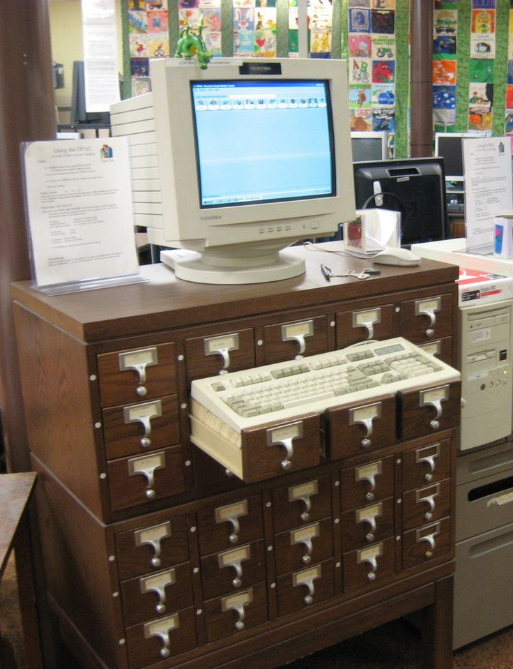 """11 Uses for Repurposed Library Card Catalogs -- While this may not find a place in your home, reusing card catalogs as a station for the computer-assisted Dewey Decimal system is both ingenious and hilarious, as seen via Library By Design.""  More at click-through.Libraries, Cards Catalog, Dewey Decimal Signs, Computers Stations, Computers Desks, Catalog Computers, Catalog Repurposing, Kiva, Computer Desks"