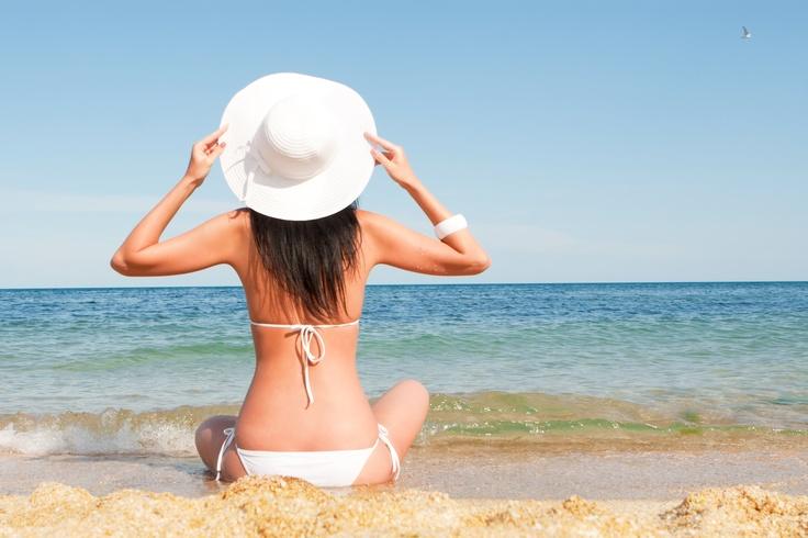 Girl enjoying sun at a beach