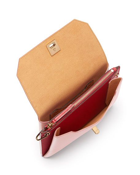 MCM colorblock grained leather clutch bag. Shiny dark golden hardware. Removable, adjustable shoulder strap. Flap top with turn-lock clasp. Back slip pocket. Interior, center zip compartment; card slo