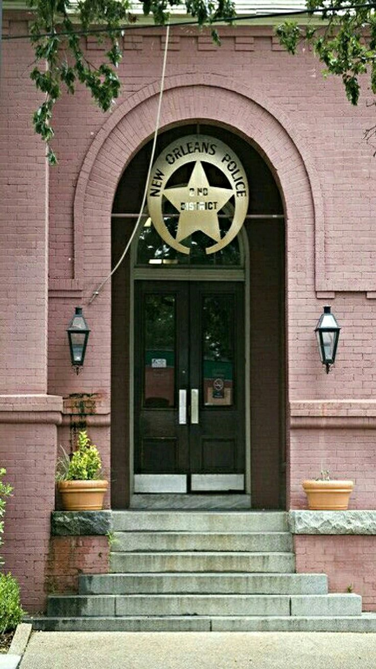 Police station doors in the Garden District of New Orleans. - by Ned Fielden