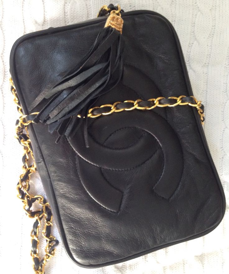 Vintage 1970s Chanel black kid leather bag with logo and chain strap