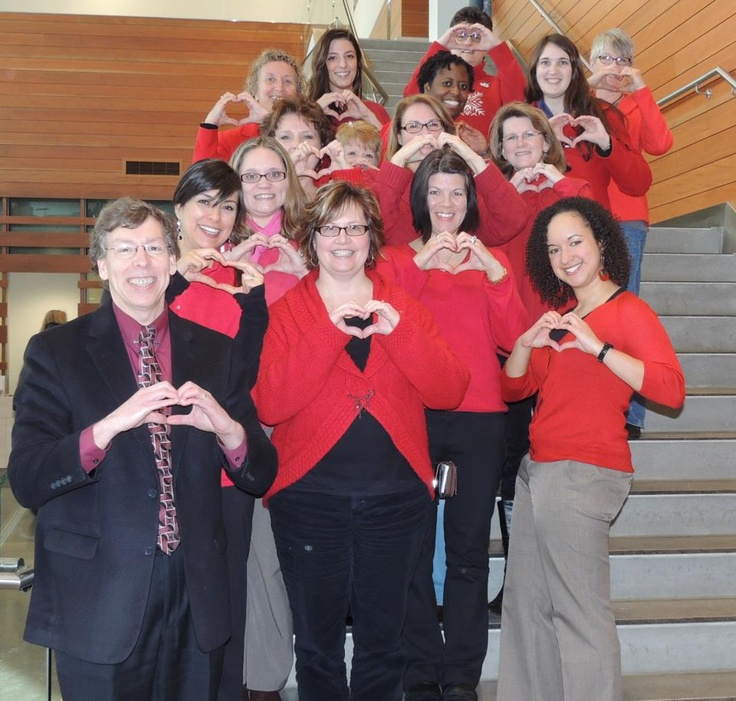Staff members sporting red to show support against women's domestic violence