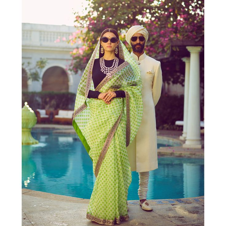 One of my big inspirations comes from my endless archive of black and white photographs of pre and post independent India. Some of the most iconic pictures are of women at polo matches across the country.  On Her: A classic hand-printed polka dot organza saree with a crystal border and a textured raw silk full sleeve blouse. The look is accessorised with retro sunglasses and a lavish earring and neckpiece set in uncut and fine-cut diamonds from the Sabyasachi Heritage Jewelry collection.  On…