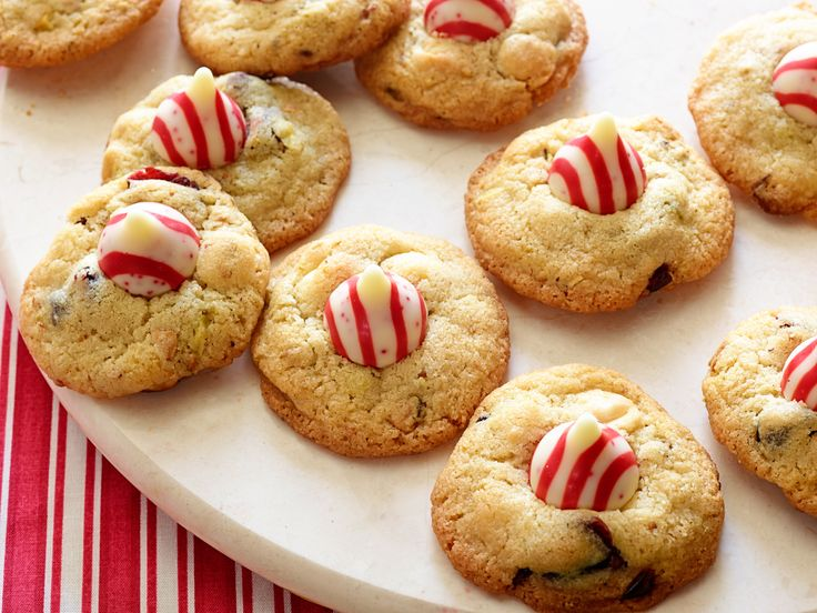 Nancy Fuller's Christmas cookies are filled with macadamia nuts and almonds and finished with a red-and-white striped chocolate kiss candy.
