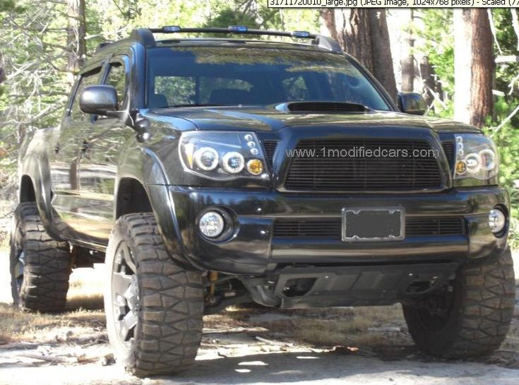 Modified custom Toyota Tacoma Xtra Cab blackout offroad main
