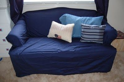 DIY couch cover --the lazy way. One King Size Flat Sheet just folded and pinned in needed areas....hmmm.
