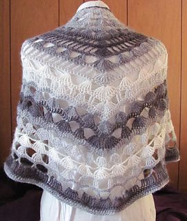 This shawl is worked from the top down and you choose whether it's smaller or larger based on the yarn and hook. Models shown are lace weight with size F hook and worsted weight with size I hook. The pattern of increases at the beginning creates a bit of shoulder shaping. For smaller hooks, I recommend using a pin to keep the shawl closed.