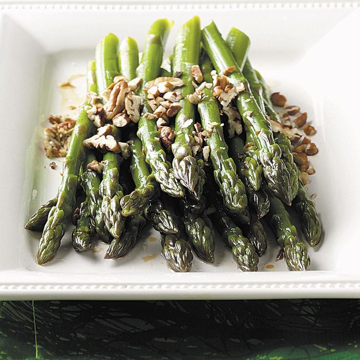 Fresh Asparagus with Pecans Recipe -This is one of my family's favorite special occasion dishes. We all love the fresh taste of asparagus and we know it's healthy, too! —Jennifer Clark, Blacksburg, Virginia