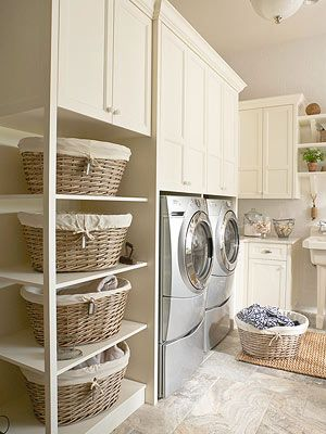 laundry room. love the cabinets for bedding/towel storage. the laundry room will be big enough to do this, i think.