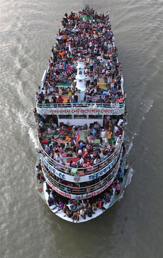 Passengers crowd on to a ferry leaving Dhaka, Bangladesh, ahead of the Eid al-Fitr holiday.
