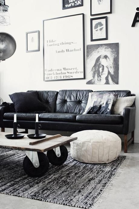 Industrial style living room with black leather sofa