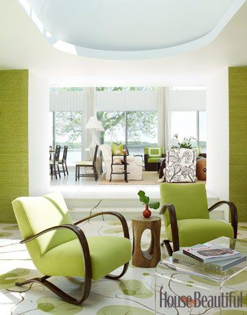 The star in the living room of this modern beach house in Oyster Bay, New York, is underfoot: a hand-painted lily-pad pattern covers the sunken floor. Designer Christina Murphy found the print in an old textile book and had it replicated for a fun and fresh look. Ngoc Minh Ngo  - HouseBeautiful.com