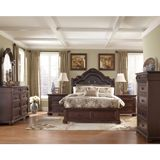 Ashley Caprivi King/Cal King/Queen UPH Panel HBD with Storage BDRM Set - With the deep brown finish flowing smoothly over the detailed pilasters and ornamentally decorated corbels, the sophisticated Old World beauty of the Caprivi bedroom collection features a plush button tufted upholstered headboard adorned with nail head details making every inch of this furniture a feast for the senses.