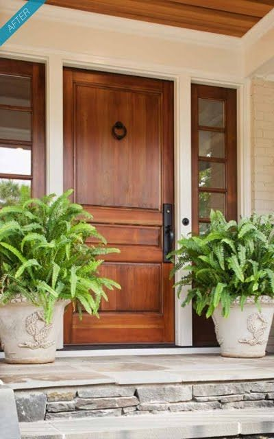 Stained wood shows grain, gives the entry a natural feel in combination with planters