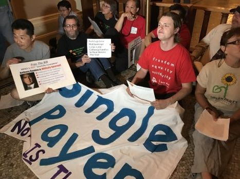Supporters of a California single-payer health care proposal, Senate  Bill 562, stage a sit-in outside the office of Assembly Speaker  Anthony Rendon. (Katy Murphy/Bay Area News Group)