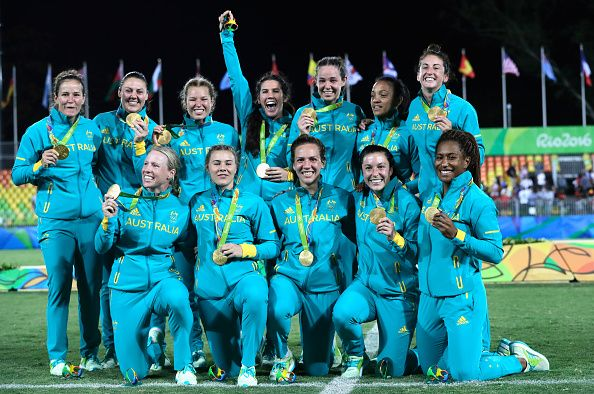 Gold medalist team Australia celebrate with their gold medal after the medal ceremony for the Women's Rugby Sevens on Day 3 of the Rio 2016 Olympic...