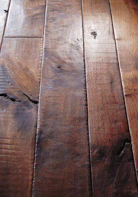 Flooring that looks clean even when it's not... darker color, high color variation, matte, distressed finish.  The more it looks like the wood on the wall at Freebird World Burrito, the better.