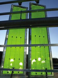 """The algae-filled walls of Splitterwerk Architects' sustainable BIQ house. The five-story structure, which will be unveiled at the International Building Exhibition in Hamburg, Germany, in March, has a facade of glass panels brimming with fast-growing microalgae. By harnessing the miracle of photosynthesis, the plants can convert light into enough heat and biomass energy to power the entire zero-carbon building"""
