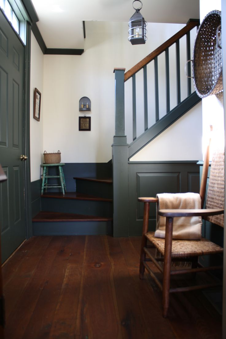 love the gray trim color for molding and door against the wood stain floor and white walls
