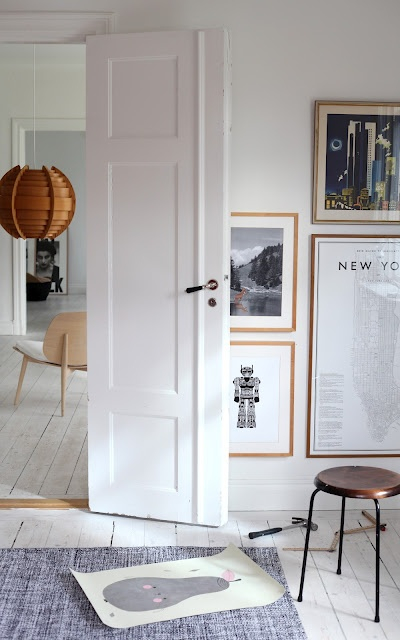 I've always loved low hanging artwork - it is a comforting new sense of place.