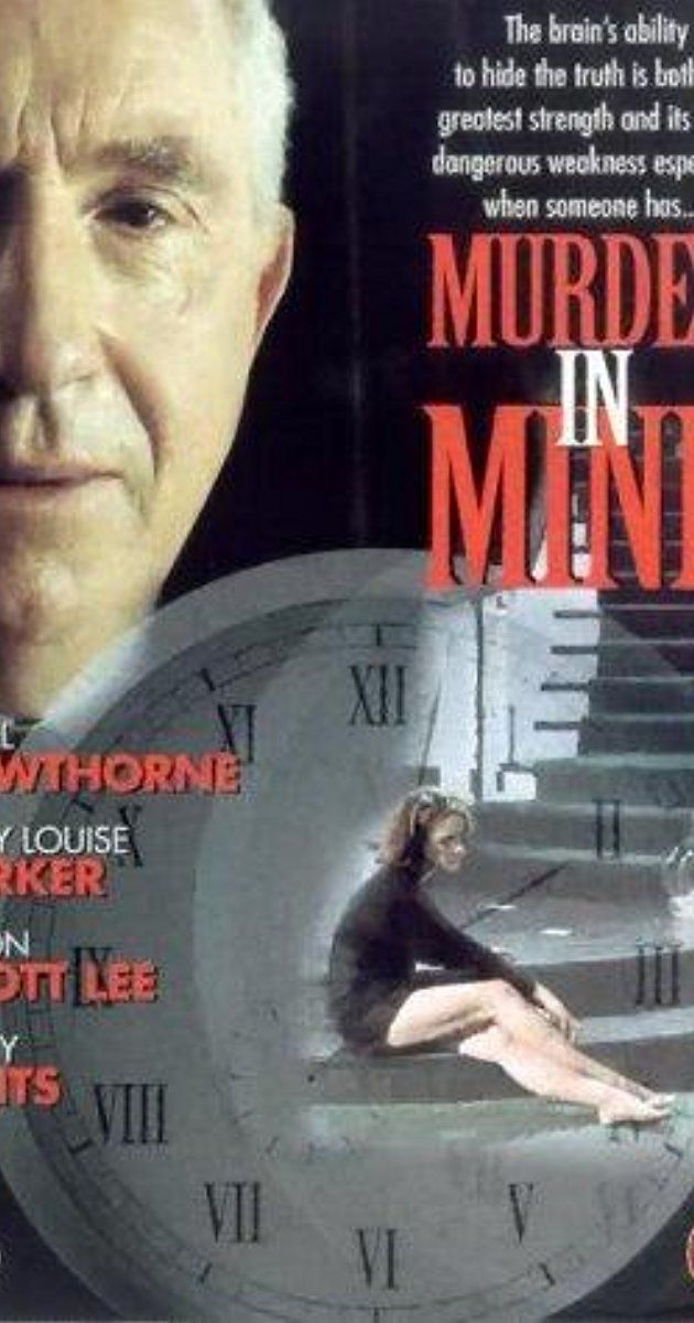 Murder in Mind 🌟🌟🌟 | Directed by Andrew Morahan. With Nigel Hawthorne, Mary-Louise Parker, Jimmy Smits, Jason Scott Lee. A woman undergoes hypnosis to determine who murdered her husband, a crime for which she is the chief suspect.