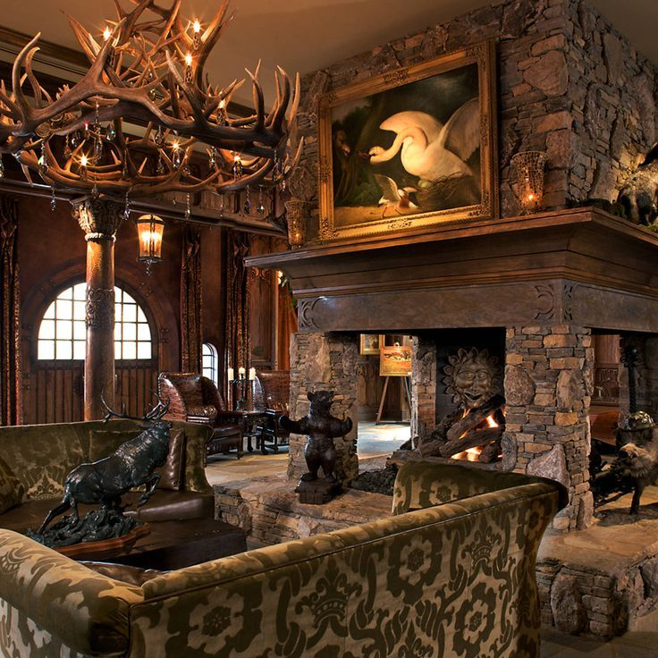 Grand Bohemian Hotel Asheville, Autograph Collection Asheville, North Carolina Fireplace Lounge Luxury Rustic sofa fire property building living room home house mansion lighting stone Lobby restaurant farmhouse cottage altar