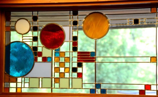 Beautiful stained glass windows lined the top of the staircase in the Hemicycle House, one of the homes on The Modern House Tour, Sunday, May 20, 2012.  New Canaan, Conn. Photo: Jeanna Petersen Shepard