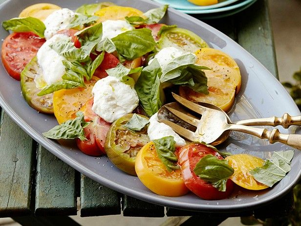 This Heirloom Tomato Caprese Salad is a fresh, healthier option that you can prepare in just 5 minutes. Ingredients: Heirloom tomatoes, Burrata cheese, basil, salt, pepper, and extra-virgin olive oil.