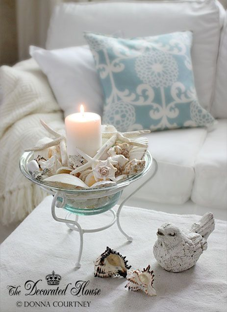 Bringing the Ocean Home With Shells (candle and shells in glass bowl w/ stand) | The Decorated House