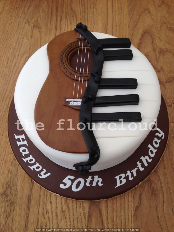 Musical themed birthday cake! Half piano and half guitar.