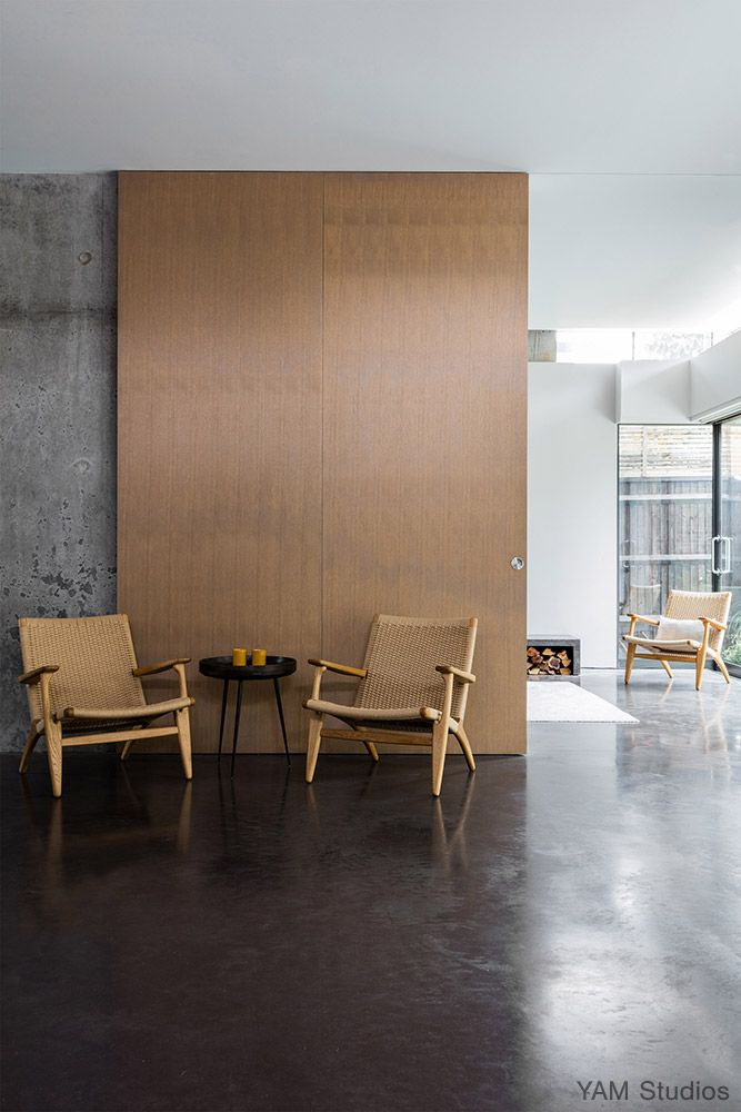 YAM Studios | Fairfax Road - Concrete floor, big wood sliding door, CH25 chair by Hans Wegner, London