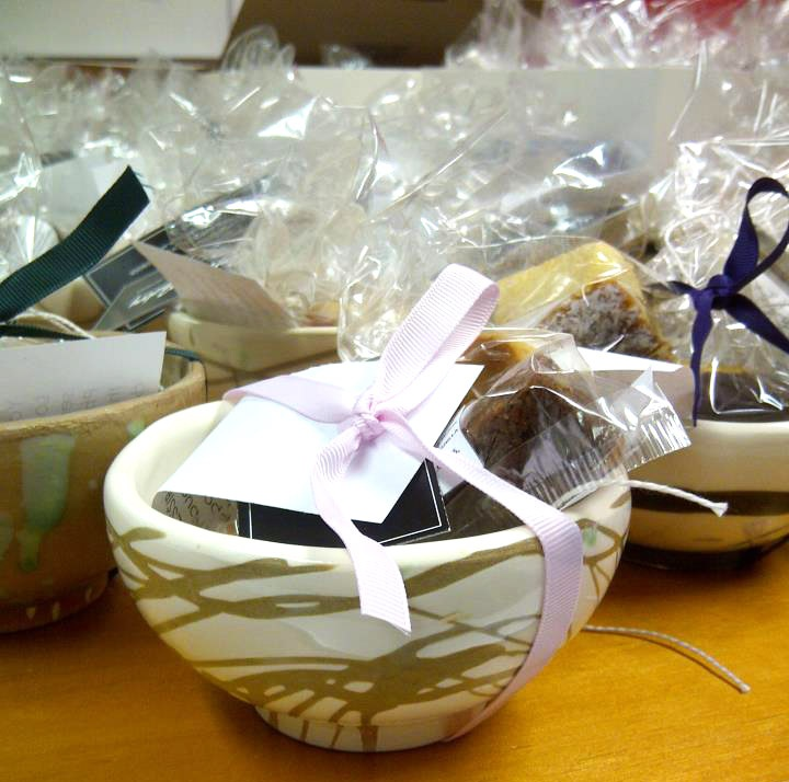 Bowl designs made by people with intellectual disabilities in Nambucca Valley Phoenix, containing Petit Fours by Artful Pastry. Made for the Walsh Bay Arts Table.
